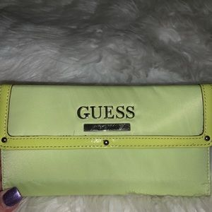 A lime colored guess wallet